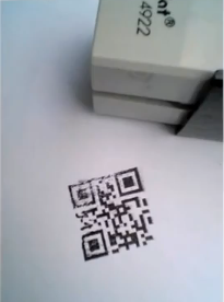 QR code stamps on dollar bills and other printed material.